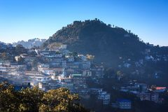 Gun hill and the houses of Mussoorie. As seen from the Landour approach road. Gun hill is a popular tourist attraction in Mussoorie, India Stock Images