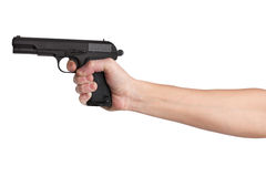 Gun in his outstretched hand of a man Stock Photo