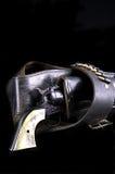 Gun in Holster on Black Stock Photo