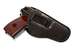 Gun in a holster on white background. Stock Image