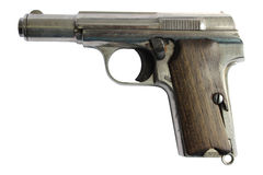 Gun isolated. Photo of old hand gun with wooden handle cover , isolated on a white background, close up. PNG format is available with full transparent background stock photos
