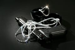 Gun and jewels over black, classic mafia image Stock Images