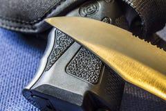 Gun and Knife Royalty Free Stock Image