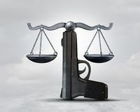 Gun Law Conceptual Idea. Gun law and weapon legislation concept as a handgun shaped as a justice scale as a legal rights idea as a 3D illustration Royalty Free Stock Photo