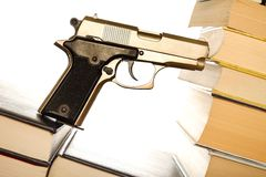 Gun law. Handgun standing on some books - for your crime literature, thriller or gun law copy stock photos