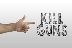 Gun laws, gun control, stop killing people concept. Kill guns text with a finger shooting like a pistol royalty free stock image