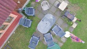 Gun left on a garden table. Aerial view of a garden furniture with a gun left on the table stock video