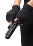 Gun loading. Woman slide and loading ammunition her pistol on white background stock photography