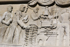 Gun loading bas relief, Portsmouth. Bas relief of Royal Navy sailors loading a gun.  Sculpted by Charles Sargeant Jagger (1885 - 1934).  Cenotaph war memorial Royalty Free Stock Photo