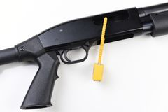 Gun Lock Inserted into the mechanism  of a Shotgun royalty free stock image
