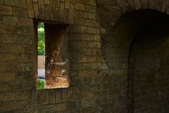 Gun loophole in the brick wall of the fortification. Of the nineteenth century The Kiev Fortress Stock Image