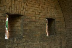 Gun loopholes in the brick wall of the fortification. Of the nineteenth century The Kiev Fortress Royalty Free Stock Image