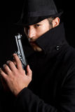 Gun Man. Dark scary man holding gun royalty free stock images