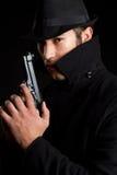 Gun Man. Dark scary man holding gun Royalty Free Stock Images