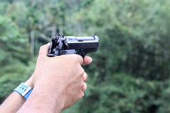Gun in man hand Royalty Free Stock Photography