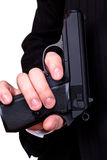 Gun in man's hand Stock Image