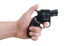 Gun in a a man's hand. Black 9mm gun in man's hand aiming Stock Images