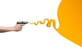 Gun in the man's hand with ribbon speech bubble Stock Images