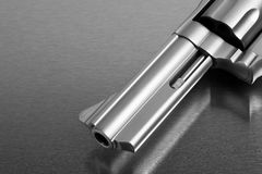 Gun on metal - modern handgun Royalty Free Stock Photography