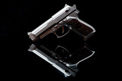 Gun in a mirror royalty free stock photo