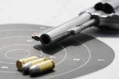 Gun with 9mm bullets on the target. Revolvers gun with 9mm bullets on the target Stock Photos
