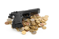 Gun and money. Gun on a lot of money. White background stock photos