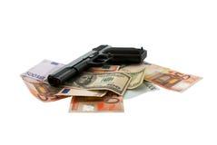 Gun and money. On a white background Stock Photo
