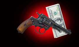 Gun and money Royalty Free Stock Photography