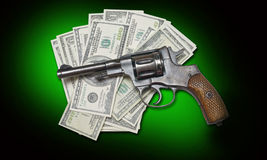 Gun and money Royalty Free Stock Photos