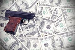 Gun on the money Stock Photo