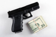 Gun and Money Royalty Free Stock Image
