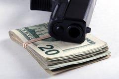 Gun and Money Stock Image