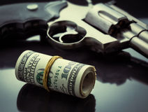 Gun and money Royalty Free Stock Images