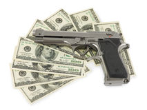 Gun and money. Isolated on white background Royalty Free Stock Photography