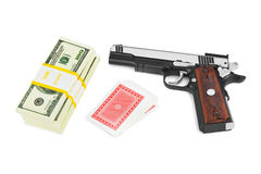 Gun money and playing cards Royalty Free Stock Photo