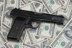 Gun and money Royalty Free Stock Photo