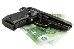 Gun and money Stock Photography