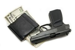 Gun and money in your wallet Royalty Free Stock Photography