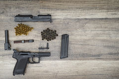 Gun with new and used bullets Stock Photography