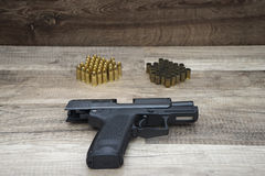 Gun with new and used bullets Royalty Free Stock Photo