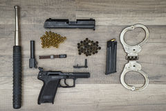 Gun with new and used bullets Royalty Free Stock Images