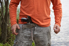 Gun  in one's belt Royalty Free Stock Images