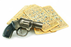 Gun and pack of cards Royalty Free Stock Images
