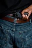 Gun in Pants Royalty Free Stock Images