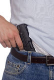 Gun in Pants royalty free stock photography