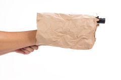 Gun in paper bag Stock Photos