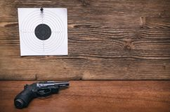 Gun and paper target. Shooting practice. Shooting range. Gun pistol and paper target. Shooting practice. Shooting range background with copy space Stock Photos