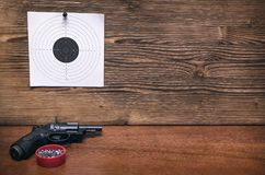 Gun and paper target. Shooting practice. Shooting range. Gun pistol and paper target. Shooting practice. Shooting range background with copy space Royalty Free Stock Image