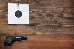 Gun and paper target. Shooting practice. Shooting range. Gun pistol and paper target. Shooting practice. Shooting range background with copy space Stock Images