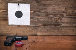 Gun and paper target. Shooting practice. Shooting range. Gun pistol and paper target. Shooting practice. Shooting range background with copy space Stock Photo